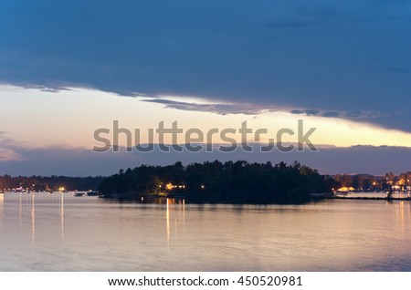 birch island in steamboat bay of east gull lake baxter minnesota at nightfall - stock photo