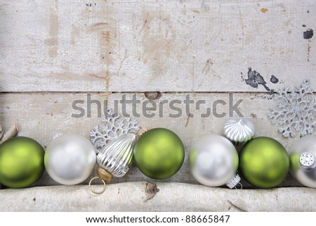 Birch log with Christmas Ornaments - stock photo