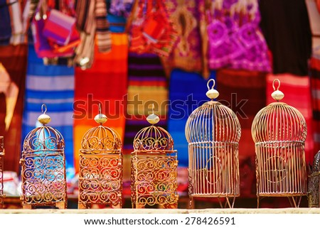 Bird cages for sale on a street in Medina of Chefchaouen, Morocco, small town in northwest Morocco known for its blue buildings - stock photo