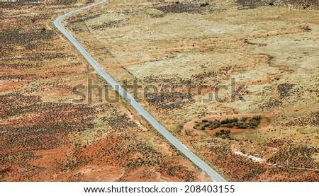 Bird eye aerial view on desert road - stock photo