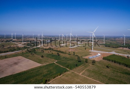 Bird Eye View High angle shots Wind turbine in a field of Thailand Aerial view of drones.