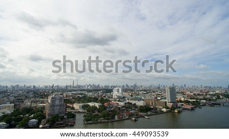 Bird eye view of Bangkok capital of Thailand with biggest river Chao phraya and dramatic sky