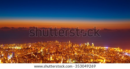 Bird eye view of beautiful night cityscape, many glowing lights in nighttime in Lebanon, picturesque scene, travel and tourism concept - stock photo