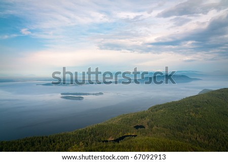 Bird-eye view of San Juan islands in Washington with Mt. Baker on the skyline