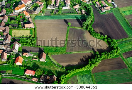 Bird Eye View of the Countryside with Village and Fields of Crops. Aerial Views. - stock photo