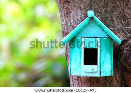 Bird house hanging from the tree - stock photo
