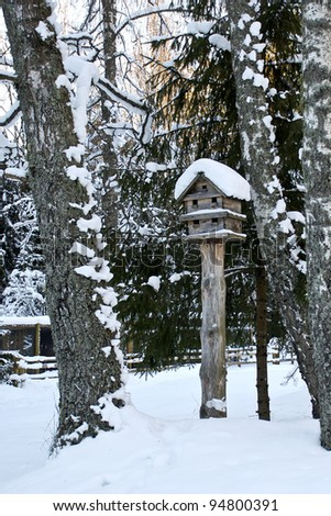 Bird house in winter - stock photo
