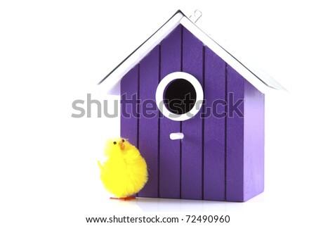 Bird house with bird on a white background. - stock photo