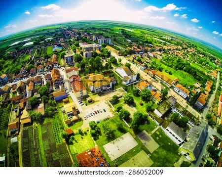 Bird perspective of village. View from the top. Fisheye lens. - stock photo
