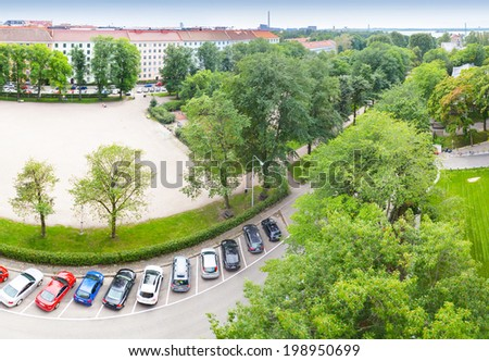 Bird perspective view on cars parking on street - stock photo