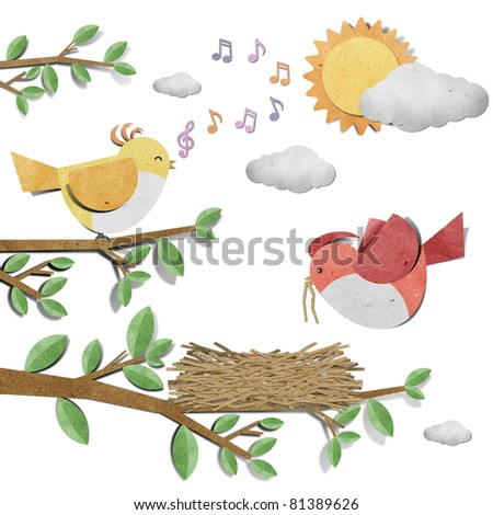 bird recycled paper craft stick on white  background - stock photo