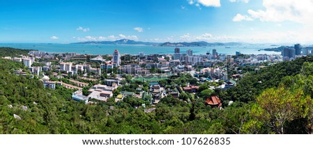 Bird's eye view of Xiamen, China and the sea - stock photo