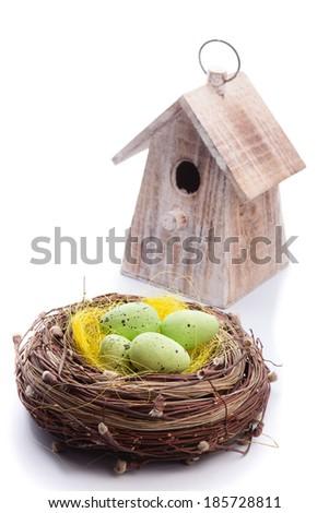 bird's nest with eggs and birdhouse isolated - stock photo