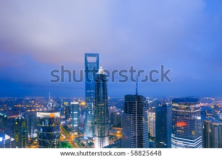 Bird view at Shanghai China. Skyscraper under construction in foreground. Fog, overcast sky and pollution. Bund (Pudong) area - stock photo