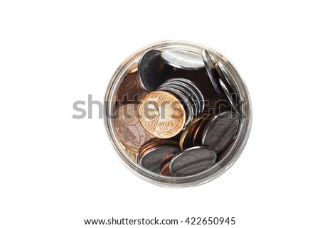 Bird view of a full jar of Brazilian coins isolated on white background - stock photo