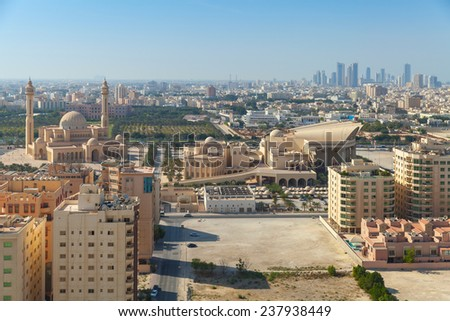 Bird view of Manama city, Bahrain. Skyline with old and modern buildings on the horizon - stock photo