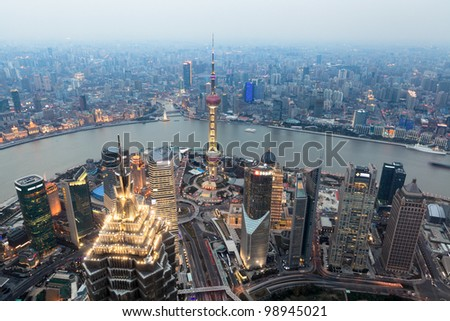 bird view of shanghai at dusk from world financial center - stock photo