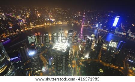 Bird view of  shanghai at night from shanghai world financial center - stock photo