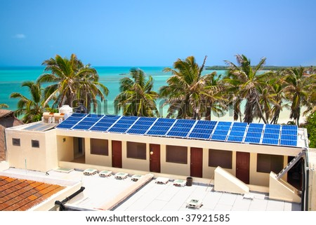 birdeye view on the beach with a building with a solar panel on the Isla Contoy, Mexico - stock photo
