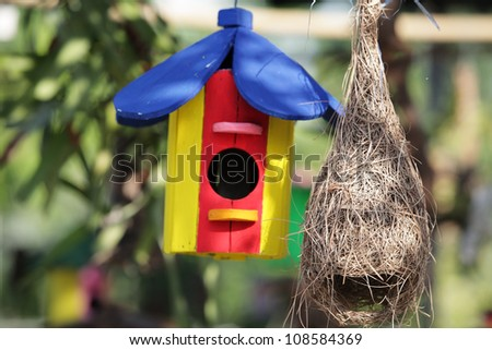 birdhouse and bird nest. - stock photo