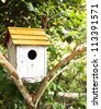 Birdhouse at park - stock photo