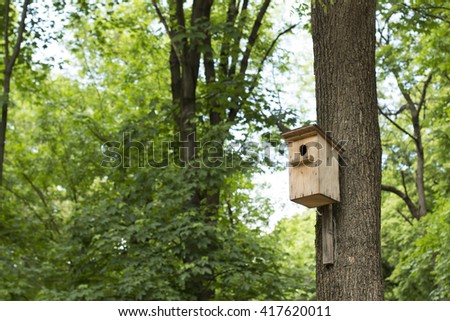 birdhouse in a tree - stock photo