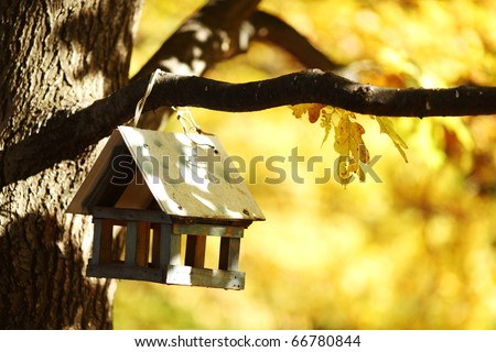 birdhouse in the autumn forest - stock photo