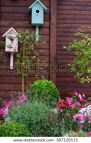 Birdhouses on a wall of cottage in a garden