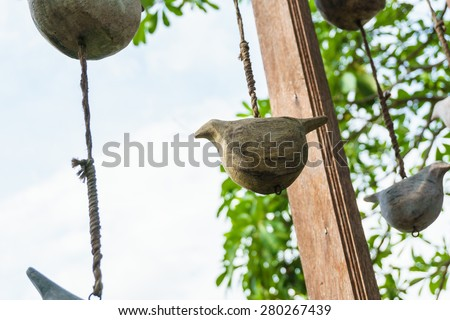 birds carved by wooden hang on wood in the garden, wooden birds - stock photo