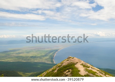 birds eye view from cliff down at Chivyrkuy bay of lake Baikal