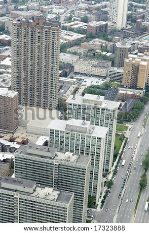 Birds eye view of apartment buildings along thoroughfare in city - stock photo
