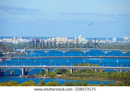 Birds-eye view of bridges of Kiev in the day, Ukraine - stock photo