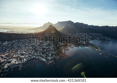Birds eye view of city of cape town with beautiful beaches and mountain range on a sunny day. Aerial view of Cape Town city with Devil's Peak. - stock photo