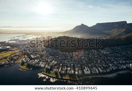 Birds eye view of city of cape town with buildings on water front on a bright sunny day. Aerial view of Cape Town city. - stock photo