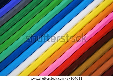 birds eye view of pencil all together in a straight line. rainbow of colours