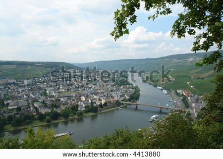 Birds eye view of the mosel valley in germany with the river and the vineyards - stock photo
