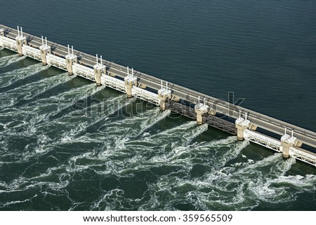 Birds eye view of the Oosterscheldekering, a storm surge barrier which is part of the delta works to protect Holland from high sea level - stock photo