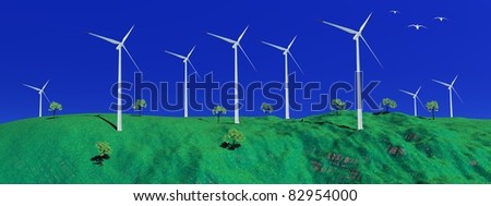Birds flying next to wind turbines at the top of a green hill with small trees