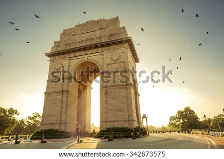 Birds flying over India Gate, New Delhi - stock photo
