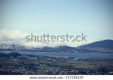 Birds view to Caminha town in the North of Portugal, also the river of Minho that divides Portugal and Spain - stock photo