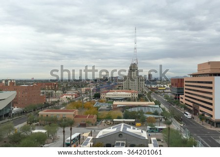 Birdseye southward view of Phoenix Downton over Central Avenue on cloudy winter day, Arizona capital city