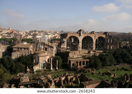 Birdseye view of Forum Romanum with Santi Cosma e Damiano (Temple of Romulus) and Basilica of Maxentius visible - stock photo