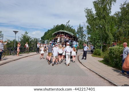 BIRKEROED, DENMARK - JUNE 23, 2016: High school graduates finishes and go by trucks to visit every students families. Graduates with the highest grades from final exam has to run after the truck.
