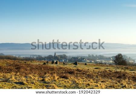 Birkrigg stone circle and Bardsea Church - stock photo