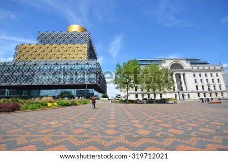 Birmingham - June 24, 2015: view of Centenary Square with the new library and Baskerville House in Birmingham, UK. A major redesign is planned for the public square in 2017.