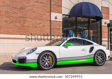 BIRMINGHAM, MI/USA - AUGUST 15, 2015: A Porsche 911, at the Woodward Dream Cruise. Woodward is a National Scenic Byway. - stock photo