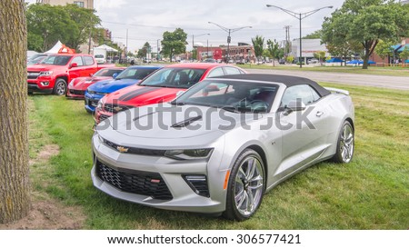 BIRMINGHAM, MI/USA - AUGUST 14, 2015: Three Chevrolet Camaro cars and a Corvette, at the Woodward Dream Cruise. Woodward is a National Scenic Byway. - stock photo