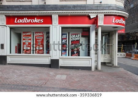 BIRMINGHAM, UK - APRIL 19, 2013: Ladbrokes betting and gaming shop in Birmingham, UK. Ladbrokes has 2,400 retail betting shops in the UK and Ireland. - stock photo