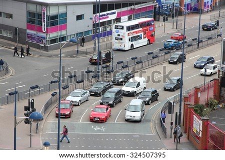 BIRMINGHAM, UK - APRIL 19, 2013: People drive cars in Birmingham, UK. Birmingham is the most populous British city outside London with 1.07 million residents.