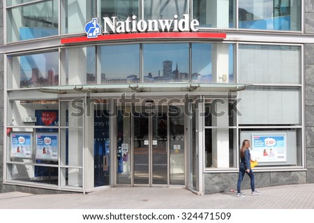 BIRMINGHAM, UK - APRIL 19, 2013: Person walks by Nationwide Building Society branch in Birmingham, UK. Nationwide Building Society Group has 193.3 billion GBP in assets (2013).